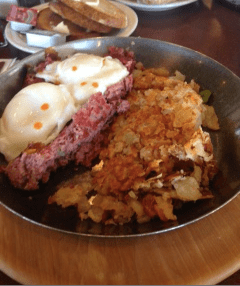 Homemade Corned Beef Hash, Poached Eggs, Home Fries, and Rye Toast