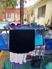 Various clothes on rack