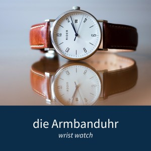 "Image showing a wrist watch and the German words ""die Armbanduhr"""