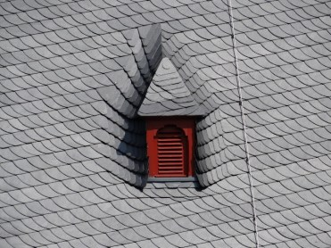 A fine bit of roofing - and a trompe l'oeil. Is the gable sticking out? Or sticking in?
