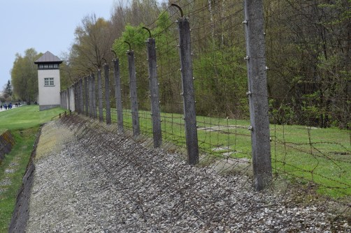 A section of fence remains at the Dachau camp