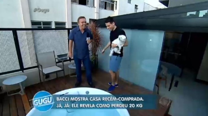 Gugu e Luiz Bacci na cobertura do rapaz (Foto: Reprodução) Record