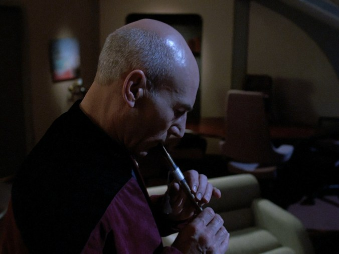 Picard playing a flute recovered from the ship of a long-dead civilization