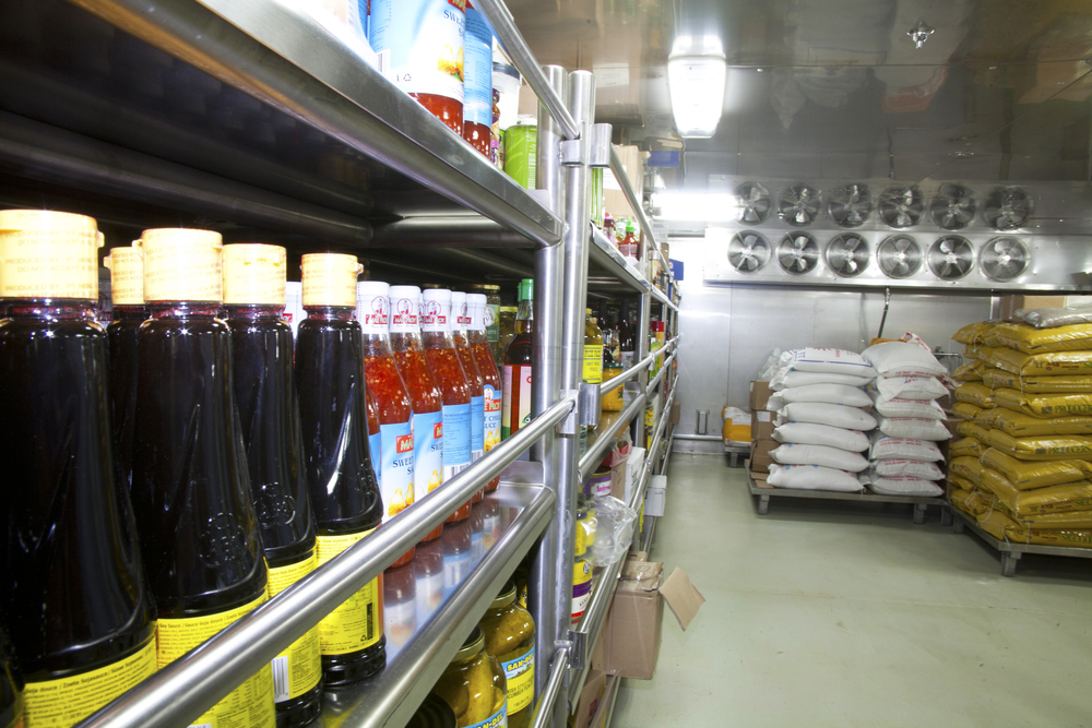 Shelves stocked with supplies in a ships galley