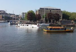 Bristol Ferry Boat Brigantia passes Bristol Packet Boat Flower of Bristol, in Bristol Harbour, with The Arnolfini behind. Chris j woo