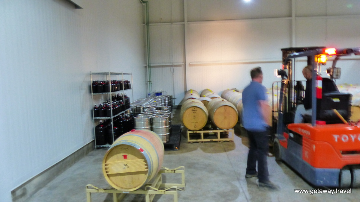what looks like beer barrels are the juice for topping off the barrels as they age