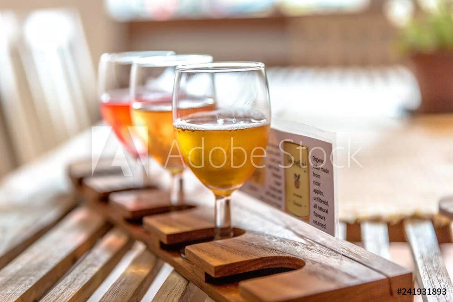 Glasses of cider in a wood table in Norway