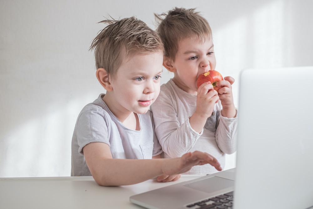 two-toddler-boys-learning-via-laptop-toghether-EVXNLHK