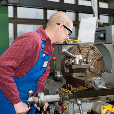 man working lathe in factory freepoint technologies