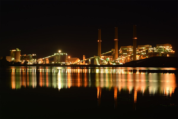 skyline factory water reflection chimneys freepoint technologies