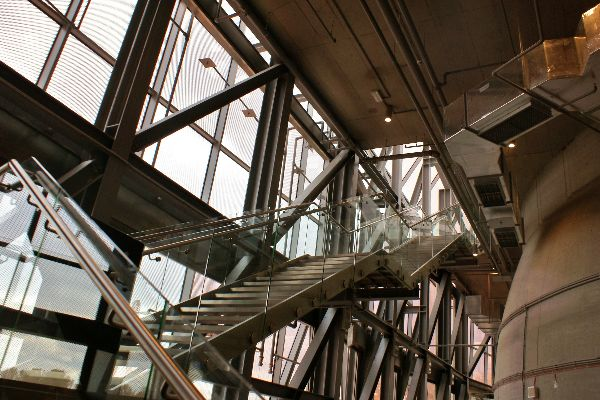 metal stairs large windows exposed metal supports large vents freepoint technologies