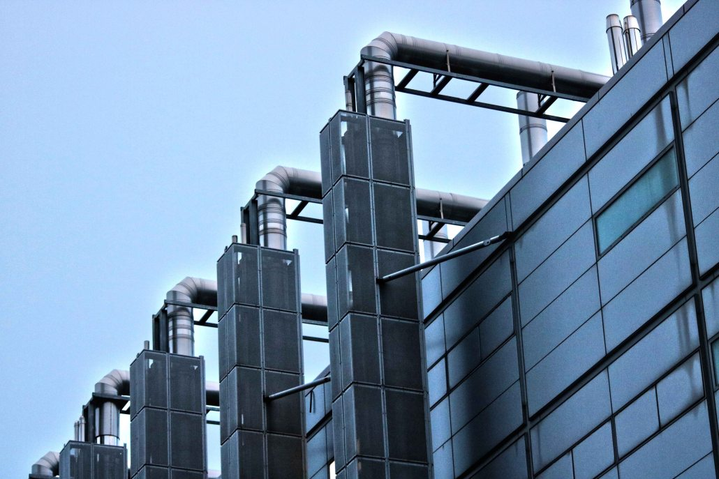 factory pipes outside metal wall blue sky freepoint technologies