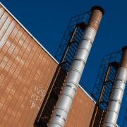 smoke stacks factory blue sky freepoint technologies ladder