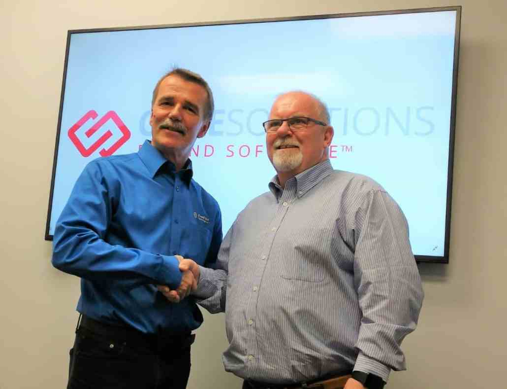 FreePoint and CoreSolutions CEO Shake Hands