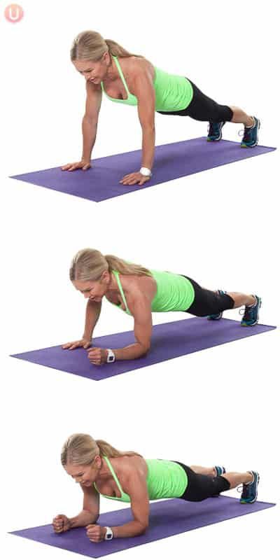 Chris Freytag demonstrating army crawl plank in a green tank top on a purple yoga mat