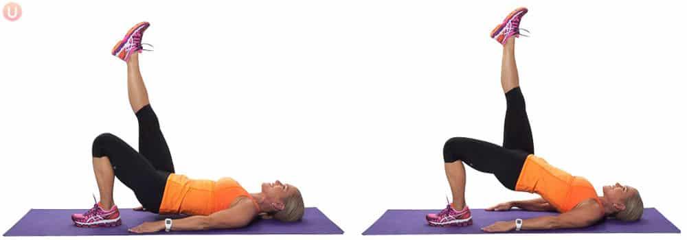 Chris Freytag demonstrating Single Leg Hamstring Bridge in an orange tank top on a purple yoga mat