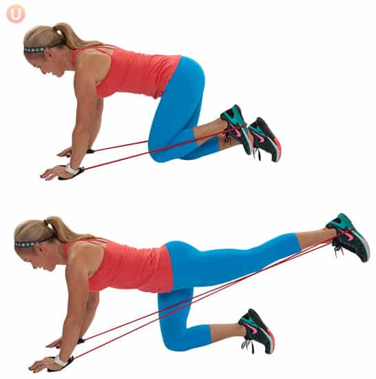 Try moves like this butt blaster to tone your glutes using a resistance band.