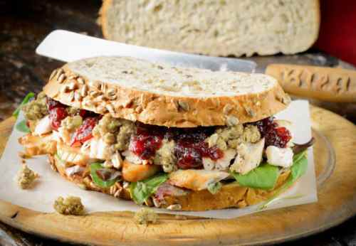 Upgrade the basic turkey & mayo with a pumped up version using all your Thanksgiving leftovers.