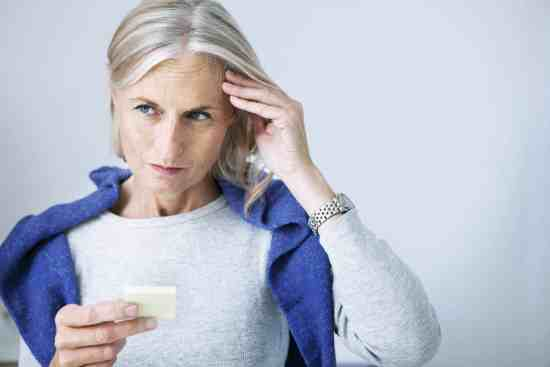 Older woman forgetting something