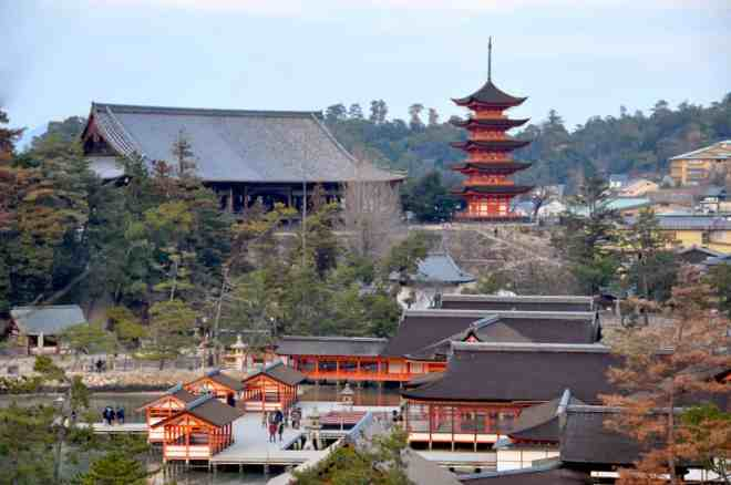 View over Itsukushima Shrine and over to the five story pagoda and the 1000-mat pavilion on Miyajima in Hiroshima, Japan