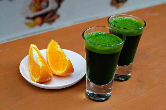 Organic wheatgrass shots at Verite cold pressed juice in Hiroshima, Japan