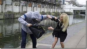 man mugging woman