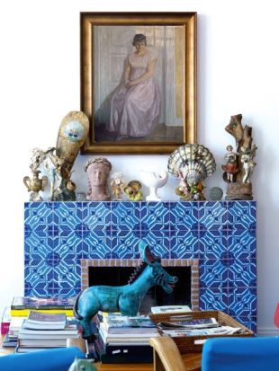 An exotic tile fireplace with a lot of character.