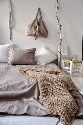This Bohemian styled bedroom looks clean and simple thanks to a neutral color scheme.
