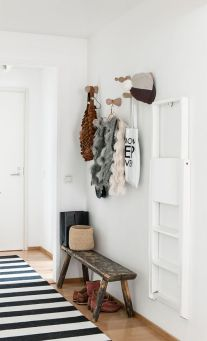 A uniform striped rug creates composure between an active wall.