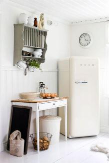 A neutral kitchen with hints of greenery.