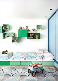 A green bedroom with toys.