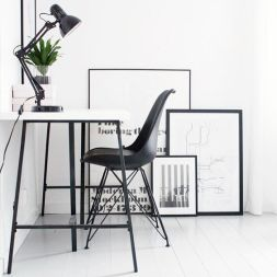 Keep your desk clutter-free but decorate the walls around you.