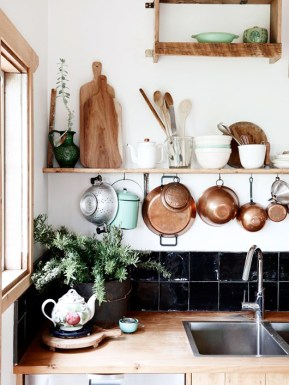 Add a modern spin to a traditional kitchen by updating the countertops with fresh wood, copper accents, and mint.