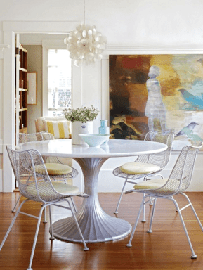 For a neutral furnishing palette, add pops of color through displayed art.