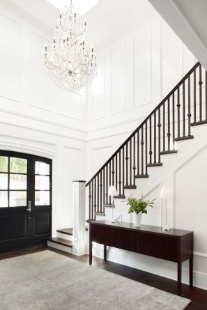 This extravagant chandelier brings out the beauty in this two-story foyer.