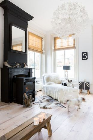 Create a fancy focal point by mixing a white wall with a black fireplace.