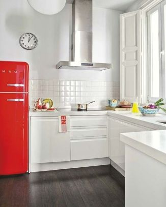 A pop of red to bring out the modern kitchen appliances.