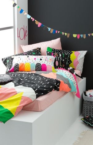 Vibrant colors and patterns for this modern girl's bedroom.