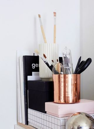 Stack and group your office supplies to create more space.
