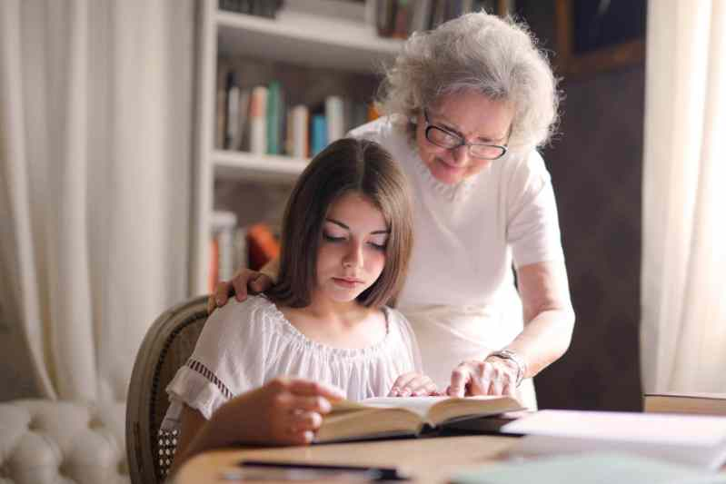 Grandmother and Granddaughter studying