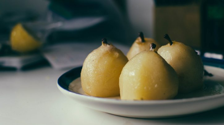 sideview of four poached pears cooling on a plate - The Mummy