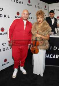 NEW YORK, NY - OCTOBER 17: Fat Joe (L) and Ezinma attend the TIDAL X benefit concert powered by BACARDI and hosted by Fat Joe at Barclays Center of Brooklyn on October 17, 2017 in New York City. (Photo by Monica Schipper/Getty Images for BACARDI) *** Local Caption *** Fat Joe;Ezinma