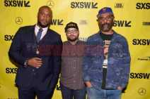 """AUSTIN, TX - MARCH 17: Director Marcus A. Clarke, senior programmer of SXSW Jarod Neece and director Sacha Jenkins attends the red carpet premiere of """"Rapture"""" during SXSW 2018 at Paramount Theatre on March 17, 2018 in Austin, Texas. (Photo by Daniel Boczarski/Getty Images for Netflix) *** Local Caption *** Marcus A. Clarke;Jarod Neece Sacha Jenkins"""