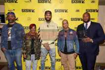"""AUSTIN, TX - MARCH 17: Director Sacha Jenkins, Rapsody, Dave East, T.I. and director Marcus A. Clarke attend the red carpet premiere of """"Rapture"""" during SXSW 2018 at Paramount Theatre on March 17, 2018 in Austin, Texas. (Photo by Daniel Boczarski/Getty Images for Netflix) *** Local Caption *** Sacha Jenkins;Rapsody;Dave East;T.I.;Marcus A. Clarke"""