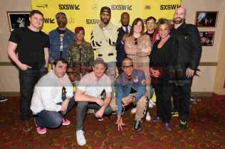"""AUSTIN, TX - MARCH 17: Netflix executive Ben Cotner, director Sacha Jenkins, Rapsody, Dave East, director Marcus A. Clarke, Netflix executive Zana Lawrence, producer Peter Bittenbender, director Geeta Gandbhir, director Ben Selkow, Chris Lopez, director Gabriel Noble and T.I. attend the red carpet premiere of """"Rapture"""" during SXSW 2018 at Paramount Theatre on March 17, 2018 in Austin, Texas. (Photo by Daniel Boczarski/Getty Images for Netflix) *** Local Caption *** Ben Cotner;Sacha Jenkins;Rapsody;Dave East;Marcus A. Clarke;Zana Lawrence;Peter Bittenbender;Geeta Gandbhir;Ben Selkow;Chris Lopez;Gabriel Noble;T.I."""