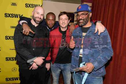 """AUSTIN, TX - MARCH 17: Director Ben Selkow, director Marcus A. Clarke, producer Peter Bittenbender and director Sacha Jenkins attend the red carpet premiere of """"Rapture"""" during SXSW 2018 at Paramount Theatre on March 17, 2018 in Austin, Texas. (Photo by Daniel Boczarski/Getty Images for Netflix) *** Local Caption *** Ben Selkow;Marcus A. Clarke;Peter Bittenbender;Sacha Jenkins"""
