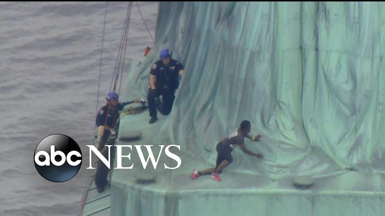 Protester arrested after climbing base of Statue of Liberty