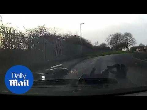 Shocking moment man on stolen motorbike slides under oncoming car - Daily Mail