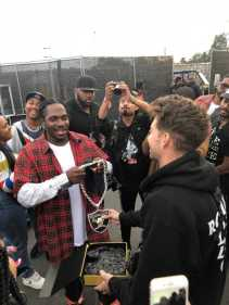 Festival Co-Founder Tariq Cherif Presents Pusha with an Oakland Raiders Inspired Rolling Loud Bay Area Chain (Photo Credit: Audible Treats)