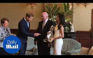Beaming Meghan is presented with 'first baby gift' in Sydney